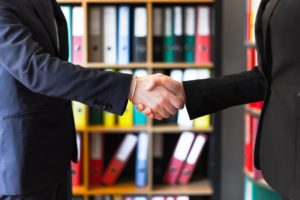 photo of two people shakehands